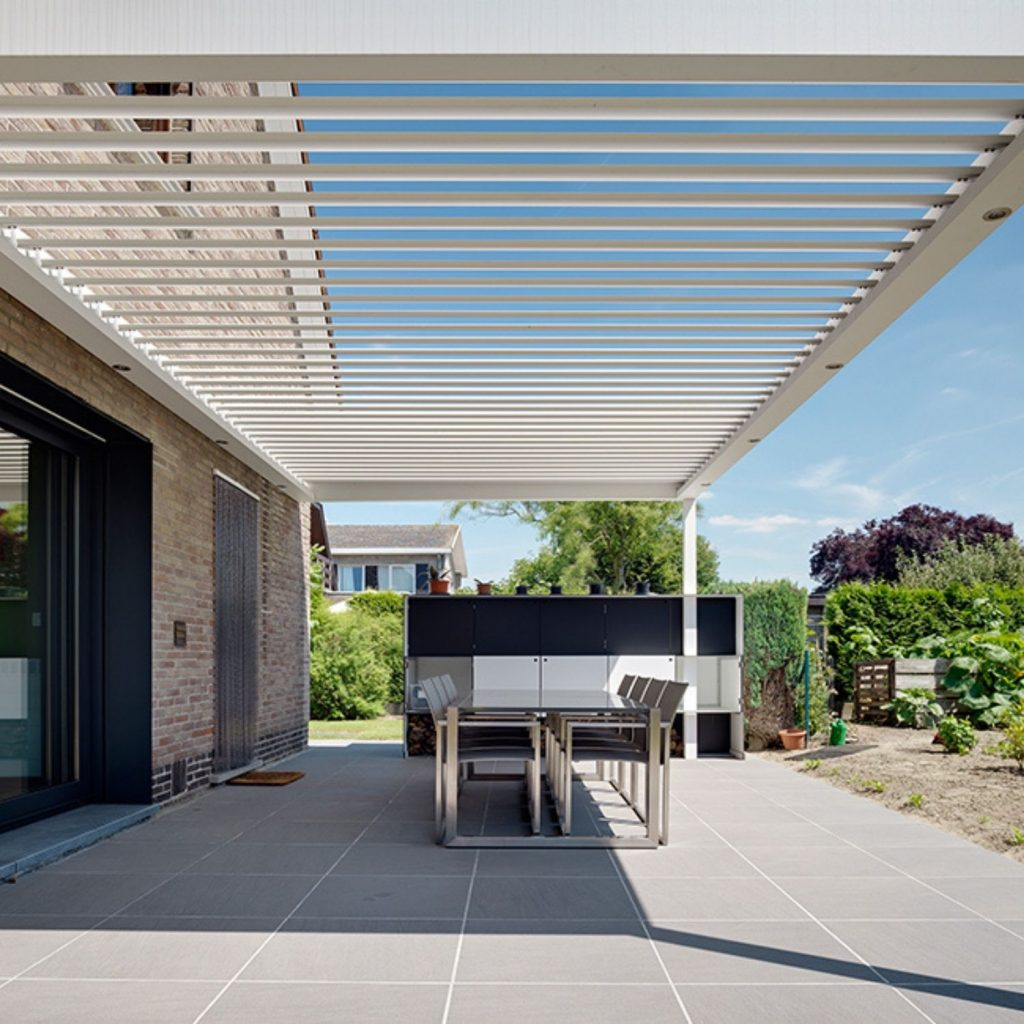 large patio roof with adjustable louvres for outdoor seating weather protection and shading