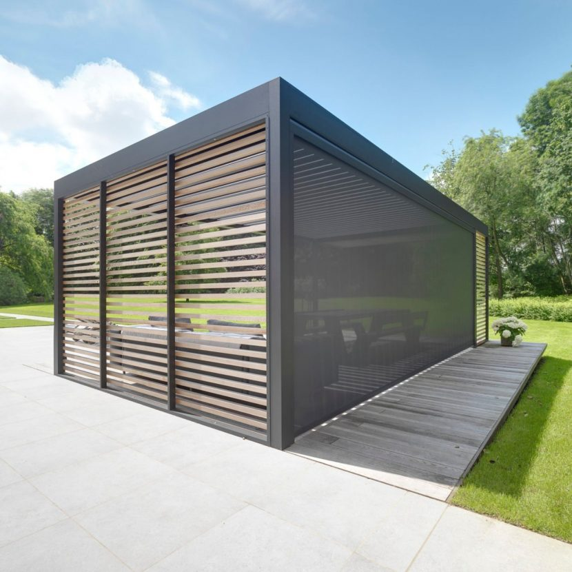 freestanding louvre roof with vertical louvres and retractable blinds to create a modern outdoor seating area that can be used all year round