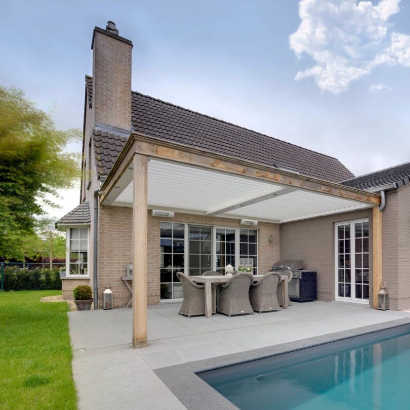 residential patio roof with adjustable louvres for optimal shading while sitting or eating on the patio