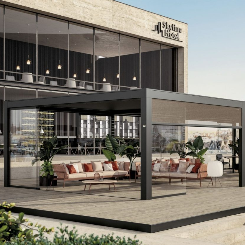 luxury hotel with contemporary outdoor seating area protected by an aluminium outdoor louvre roof