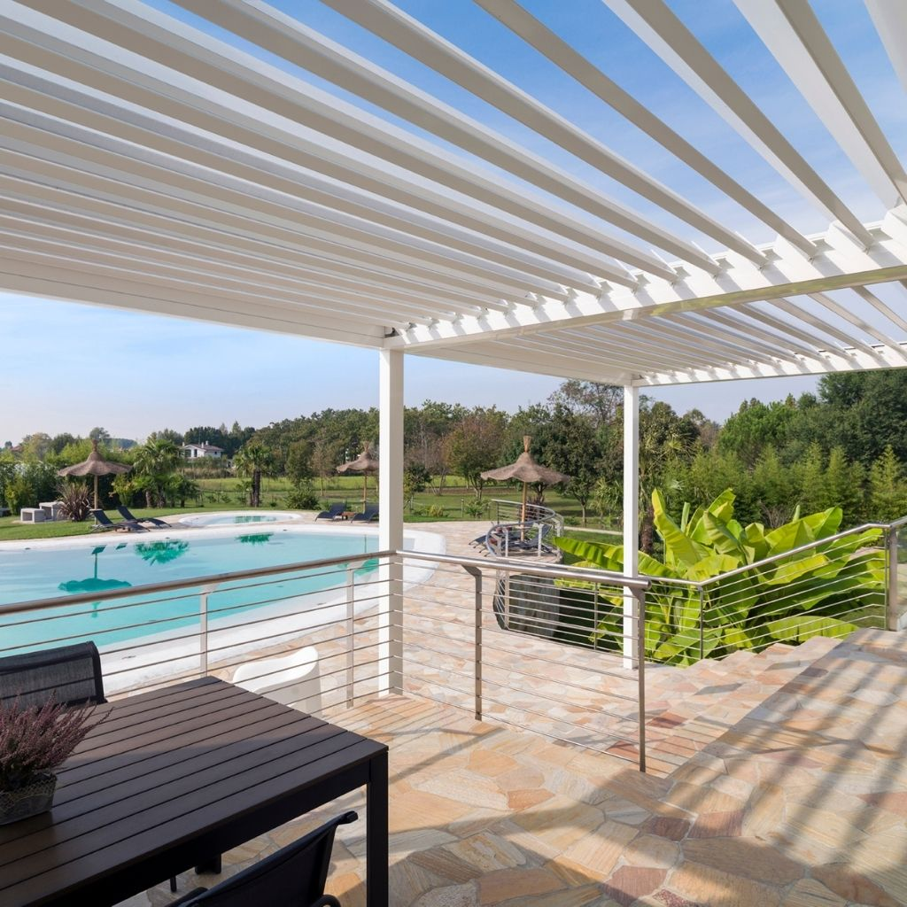 iq louvre roof used to create the perfect poolside seating area