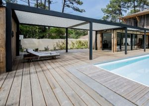 Camargue Roof next to pool with sun loungers