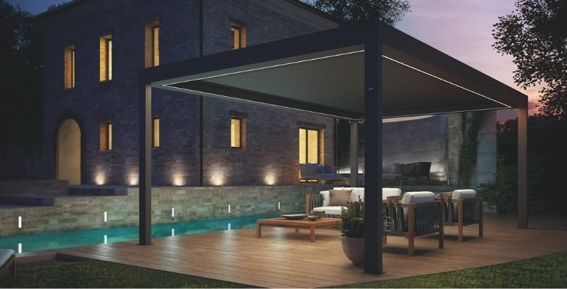 Louvre next to pool with LED lights around home