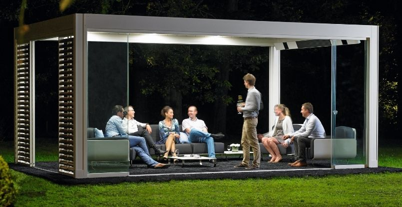 Camargue pod with led strip lighting inside with people drinking around a table with a bottle of champagne