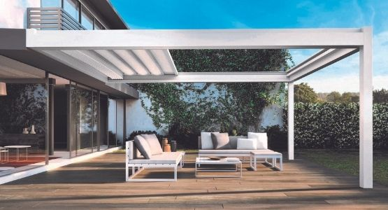 IQ Retractable Awning Roof mounted to the rear of a home used as a modern retractable garden patio roof
