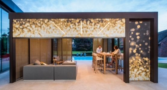 Renson Camargue Roof with retractable blinds used to create a modern outdoor patio seating area